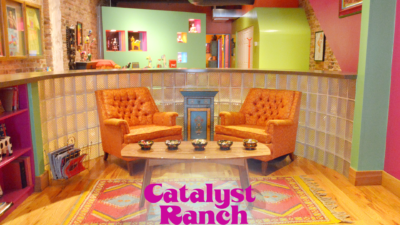 A Catalyst Ranch Zoom virtual background photo of the Samba Room, with the magenta logo at the bottom.