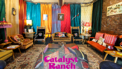 A Catalyst Ranch Zoom virtual background photo of the Polka Room, with the magenta logo at the bottom.