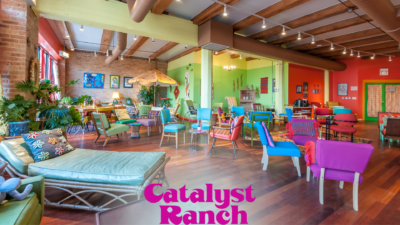 A Catalyst Ranch Zoom virtual background photo of the Jitterbug Room, with the magenta logo at the bottom.